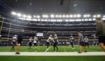 The New Orleans Saints run drills during during NFL football practice in Arlington, Texas, Tuesday, Aug. 31, 2021. (AP Photo/LM Otero)