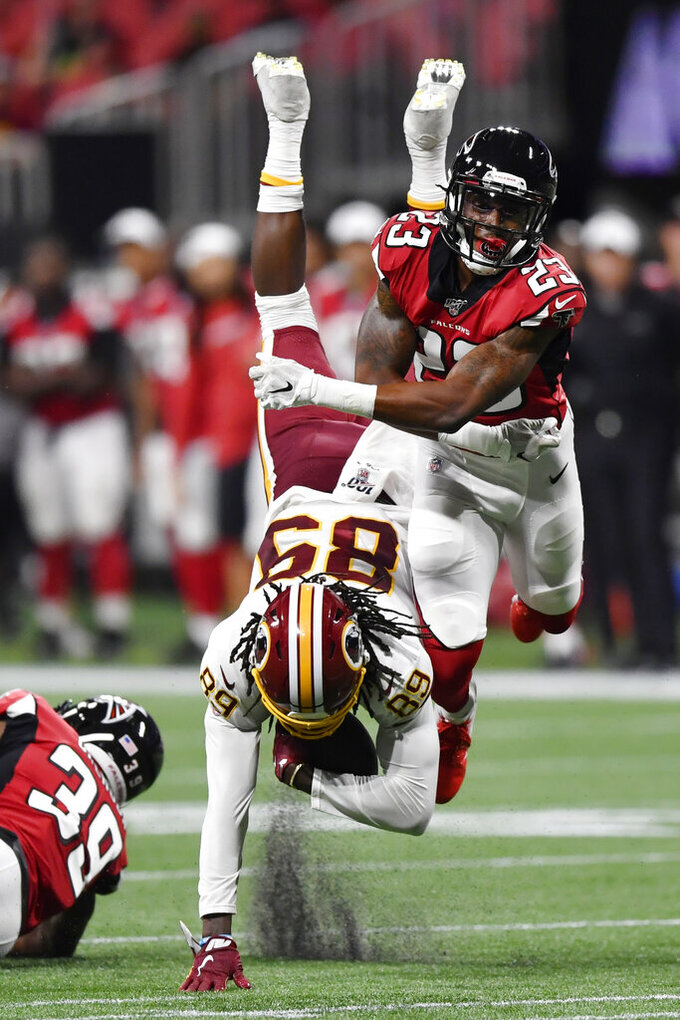 Atlanta Falcons defensive back Jayson Stanley (23) hits Washington Redskins wide receiver Cam Sims (89) during the second half an NFL preseason football game, Thursday, Aug. 22, 2019, in Atlanta. (AP Photo/Mike Stewart)