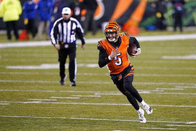 Cincinnati Bengals quarterback Ryan Finley (5) runs for a touchdown during the second half of an NFL football game against the Pittsburgh Steelers, Monday, Dec. 21, 2020, in Cincinnati. (AP Photo/Bryan Woolston)
