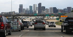 FILE--In this Thursday, July 11, 2019, file photograph, southbound Interstate 25 traffic lanes bog down to a crawl at the interchange with Interstate 70 just north of downtown Denver. To address the complications of an aging road system and a fast-growing population, Coloradoans will decide at the polls on Tuesday, Nov. 5, if the state can permanently keep tax revenue that otherwise would be refunded under limits set by a constitutional amendment called the Taxpayer's Bill of Rights, or TABOR. (AP Photo/David Zalubowski, File)