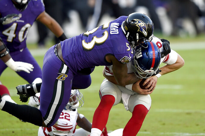 Baltimore Ravens defensive end Jihad Ward (53) sacks New York Giants quarterback Daniel Jones (8) during the second half of an NFL football game, Sunday, Dec. 27, 2020, in Baltimore. (AP Photo/Gail Burton)