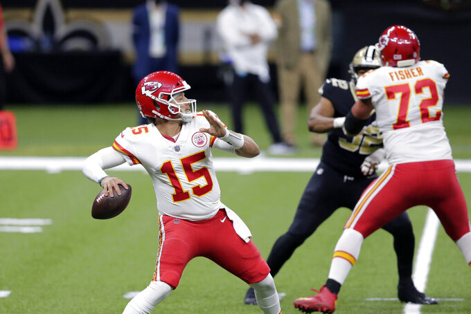Kansas City Chiefs quarterback Patrick Mahomes (15) drops back to pass in the first half of an NFL football game against the New Orleans Saints in New Orleans, Sunday, Dec. 20, 2020. (AP Photo/Brett Duke)
