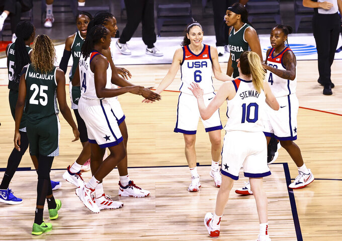 United States guards Sue Bird (6) and Jewell Loyd (4) gather with teammates during a break while playing Nigeria in the first half of a pre-Olympic exhibition basketball game in Las Vegas on Sunday, July 18, 2021. (Chase Stevens/Las Vegas Review-Journal via AP)