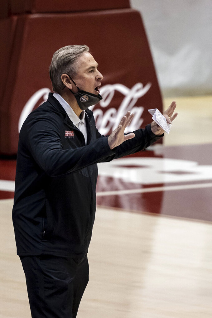 Western Kentucky head coach Rick Stansbury yells to his players during the first half of an NCAA college basketball game against Alabama, Saturday, Dec. 19, 2020, in Tuscaloosa, Ala. (AP Photo/Vasha Hunt)