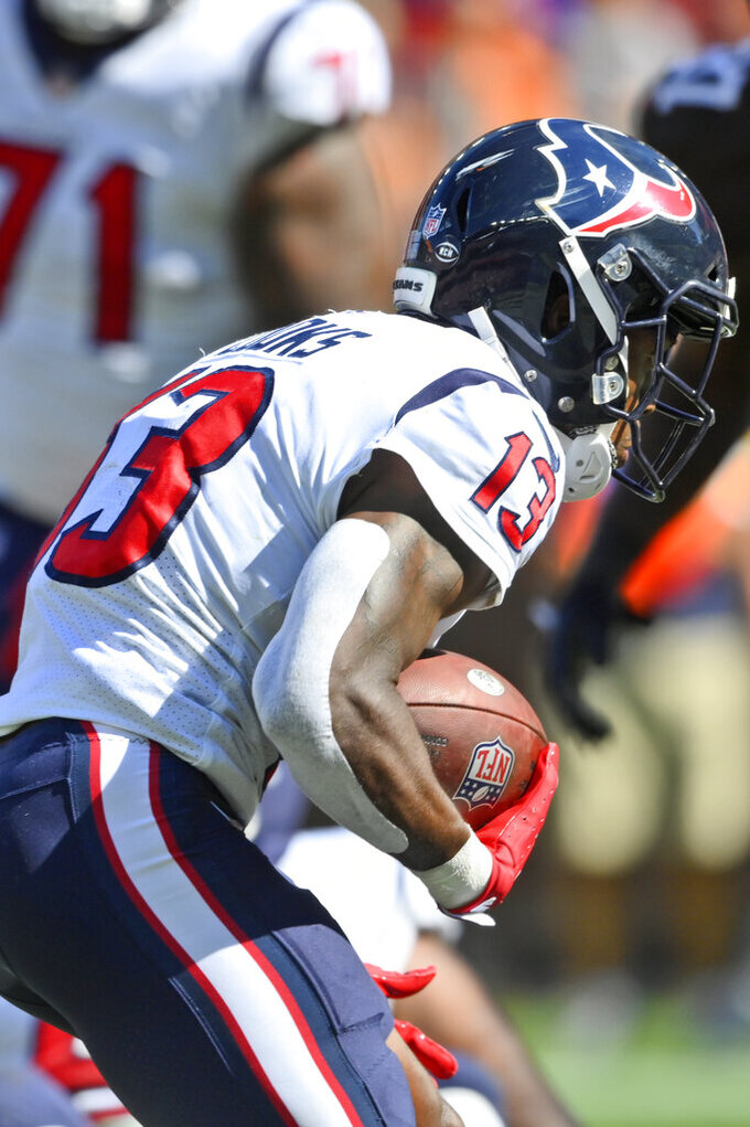 Houston Texans wide receiver Brandin Cooks (13) scores a 2-yard touchdown during the second half of an NFL football game against the Cleveland Browns, Sunday, Sept. 19, 2021, in Cleveland. (AP Photo/David Richard)