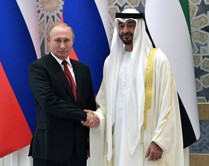 Russian President Vladimir Putin, left, and Abu Dhabi Crown Prince Mohamed bin Zayed al-Nahyan pose for a photo during the official welcome ceremony in Abu Dhabi, United Arab Emirates, Tuesday, Oct. 15, 2019. (Alexei Nikolsky, Sputnik, Kremlin Pool Photo via AP)