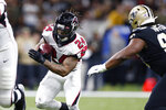 Atlanta Falcons running back Devonta Freeman (24) carries against New Orleans Saints defensive tackle Shy Tuttle (99) in the first half of an NFL football game in New Orleans, Sunday, Nov. 10, 2019. (AP Photo/Rusty Costanza)