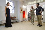 In this Sept. 4, 2019, photo, designer Herve Pierre, center, and Nicolas Caito, right, fit Emmy-nominated actress Jessica Hecht with a dress for her to wear at the Creative Arts Emmy Awards, at Atelier Caito for Herve Pierre in New York. (AP Photo/Mary Altaffer)