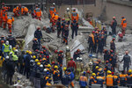 Rescue workers continue to remove rubble from an eight-story building which collapsed two days earlier in Istanbul, Friday, Feb. 8, 2019. Turkish rescue workers on Friday pulled out a 16-year-old boy from the rubble of an eight-story apartment building in Istanbul two days after it collapsed, Turkey's interior minister Suleyman Soylu said. (AP Photo/Emrah Gurel)