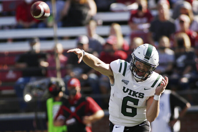 Portland State quarterback Davis Alexander throws a pass during the first half of an NCAA college football game against Washington State, Saturday, Sept. 11, 2021, in Pullman, Wash. (AP Photo/Young Kwak)
