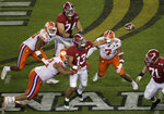 Alabama's Tua Tagovailoan throws under pressure during the second half of the NCAA college football playoff championship game against Clemson, Monday, Jan. 7, 2019, in Santa Clara, Calif. (AP Photo/Jeff Chiu)