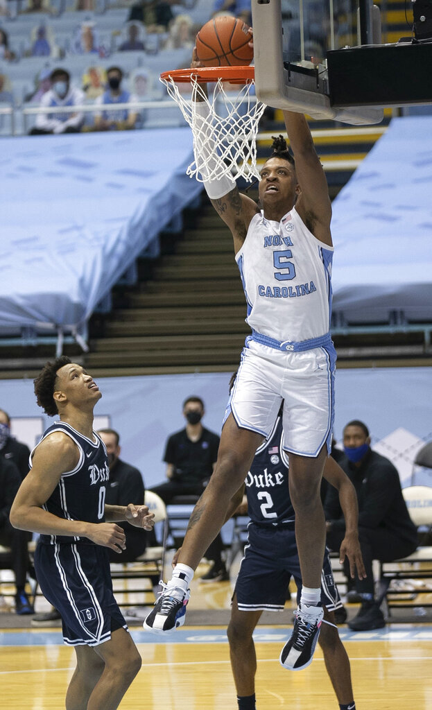 North Carolina's Armando Bacot (5) dunks over Duke's Wendell Moore Jr. (0) during the first half of an NCAA college basketball game Saturday, March 6, 2021, in Chapel Hill, N.C. (Robert Willett/The News & Observer via AP)