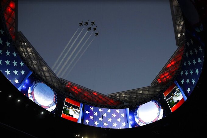 U.S. Air Force Thunderbirds fly over the open roof of the Mercedes-Benz Stadium before the NFL Super Bowl 53 football game between the Los Angeles Rams and the New England Patriots Sunday, Feb. 3, 2019, in Atlanta. (AP Photo/Carolyn Kaster)