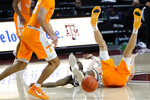 Tennessee forward John Fulkerson (10) legs go in the air after Texas A&M guard Jay Jay Chandler (0) ran into him during the second half of an NCAA college basketball game Saturday, Jan. 9, 2021, in College Station, Texas. (AP Photo/Sam Craft)