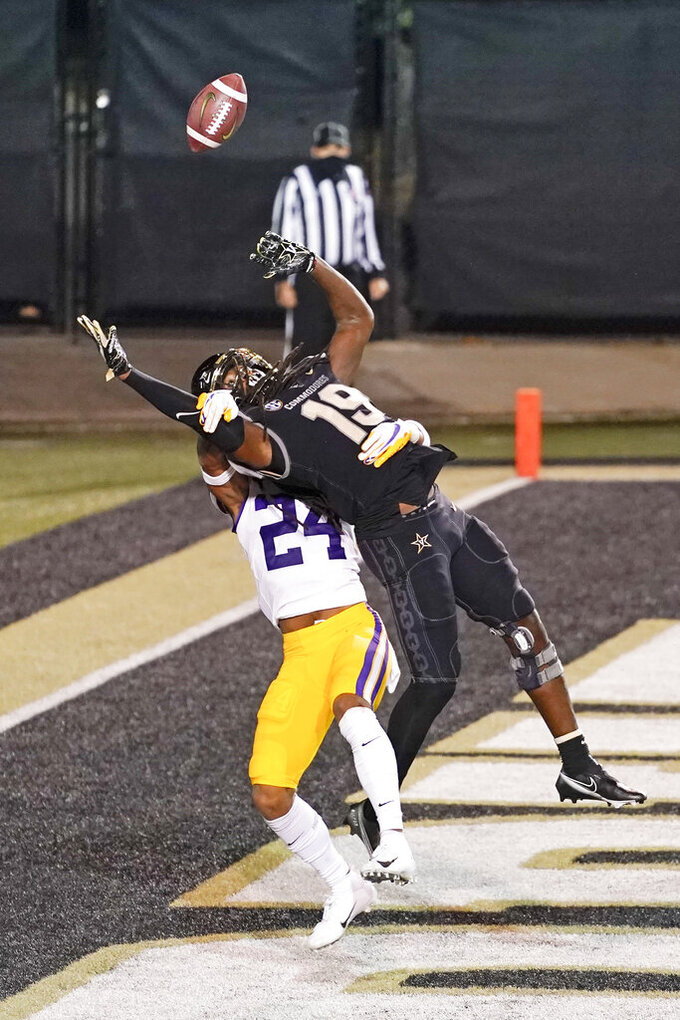 LSU cornerback Derek Stingley Jr. (24) breaks up a pass intended for Vanderbilt wide receiver Chris Pierce (19) in the first half of an NCAA college football game Saturday, Oct. 3, 2020, in Nashville, Tenn. (AP Photo/Mark Humphrey)