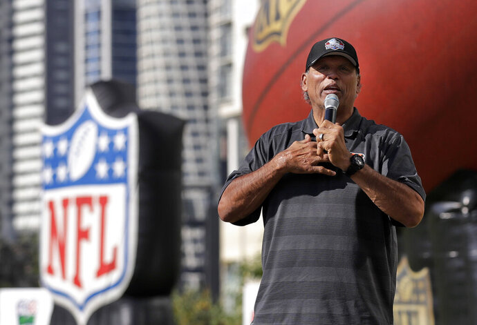 FILE - In this Nov. 17, 2019, file photo, former Cincinnati Bengals player Anthony Munoz speaks during the NFL PLAY 60 event in Mexico City. The Pro Football Hall of Fame will have three members livestream a session Friday, May 22, 2020, with Ohio youngsters as part of its Strong Youth Strong Community program. (AP Photo/Marcio Jose Sanchez, File)