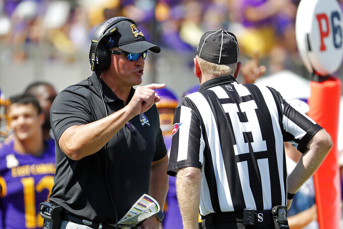 East Carolina head coach Mike Houston speaks to an official during the first half of an NCAA college football game against the South Carolina in Greenville, N.C., Saturday, Sept. 11, 2021. (AP Photo/Karl B DeBlaker)