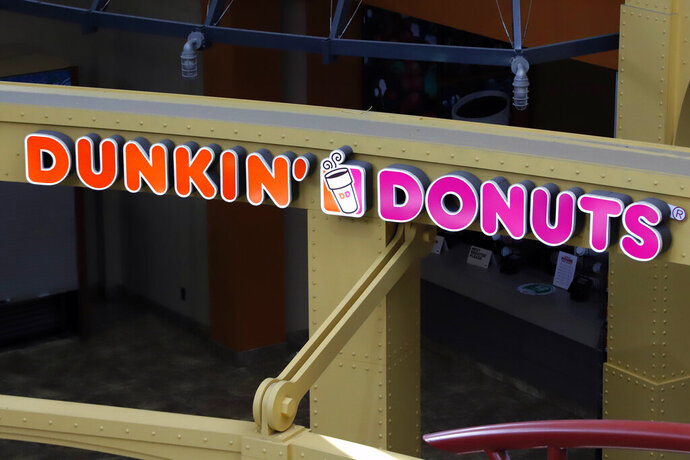 This May 7, 2020, file photo, shows a Dunkin' Donuts at the Greater Pittsburgh International Airport in Moon, Pa. The Dunkin' doughnuts and coffee chain confirmed it's held talks to be taken private by a private equity firm, sending shares rocketing to an all-time high at the opening bell Monday, Oct. 26, 2020.(AP Photo/Gene J. Puskar, File)