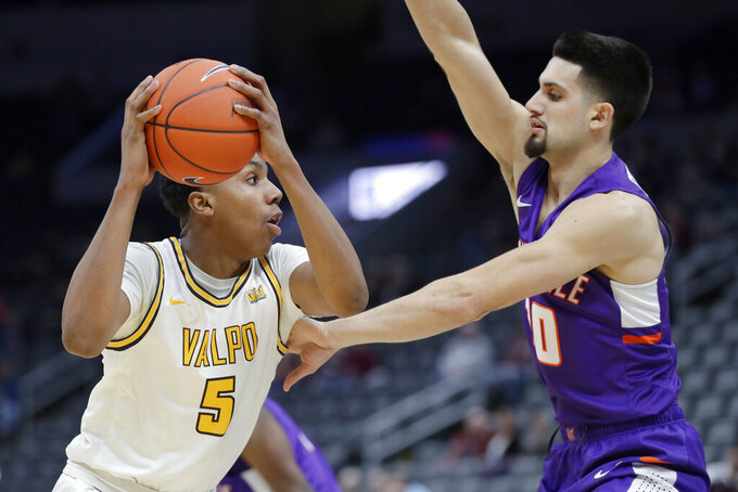 Valparaiso's Donovan Clay (5) looks to pass as Evansville's Sam Cunliffe defends during the second half of an NCAA college basketball game in the first round of the Missouri Valley Conference men's tournament Thursday, March 5, 2020, in St. Louis. (AP Photo/Jeff Roberson)