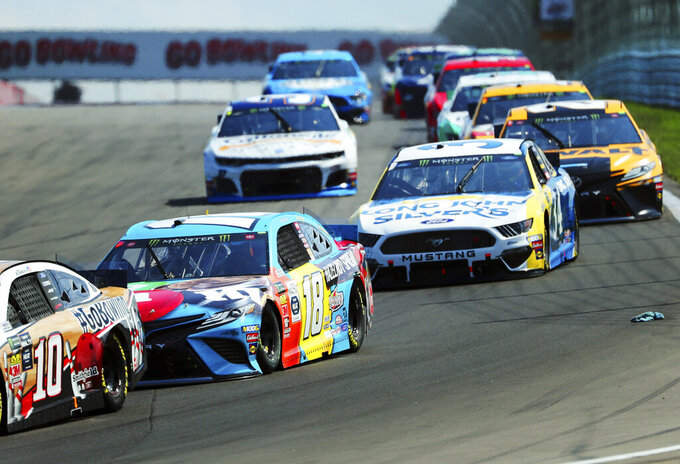 Kyle Busch (18) head into Turn 1 during a NASCAR Cup Series auto race at Watkins Glen International, Sunday, Aug. 4, 2019, in Watkins Glen, N.Y. (AP Photo/John Munson)