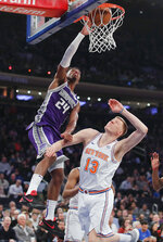 Sacramento Kings guard Buddy Hield (24) tips in a shot against New York Knicks forward Henry Ellenson (13) during the first quarter of an NBA basketball game, Saturday, March 9, 2019, in New York. (AP Photo/Julie Jacobson)