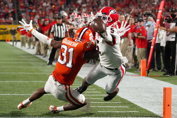 Clemson cornerback Mario Goodrich breaks up a pass intended for Georgia wide receiver Adonai Mitchell during the first half of the Duke's Mayo Classic NCAA college football game at Bank of America Stadium Saturday, Sept. 4, 2021, in Charlotte, N.C. (AP Photo/Chris Carlson)