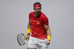 Spain's Rafael Nadal celebrates a point against Great Britain's Daniel Evans during their Davis Cup semifinal match in Madrid, Spain, Saturday, Nov. 23, 2019. (AP Photo/Bernat Armangue)