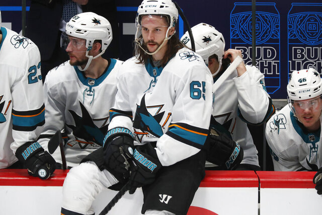 San Jose Sharks defenseman Erik Karlsson sits on the rail of the team box during a stop in play late in the third period of the Sharks' NHL hockey game against the Colorado Avalanche on Thursday, Jan. 16, 2020, in Denver. Colorado won 4-0. (AP Photo/David Zalubowski)