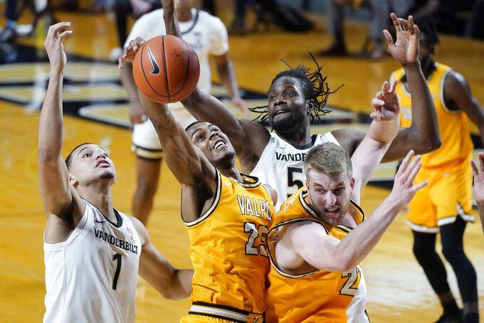 Valparaiso guard Nick Robinson (25) grabs a rebound between Vanderbilt's Dylan Disu (1) and Ejike Obinna (50) in the first half of an NCAA college basketball game Friday, Nov. 27, 2020, in Nashville, Tenn. (AP Photo/Mark Humphrey)