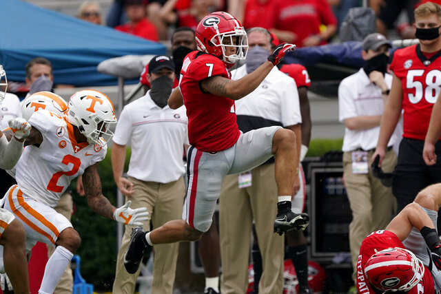 Georgia wide receiver Jermaine Burton (7) breaks away from Tennessee defensive back Alontae Taylor (2) on a long run in the first half of an NCAA college football game Saturday, Oct. 10, 2020, in Athens, Ga. (AP Photo/John Bazemore)