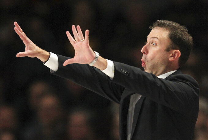 Minnesota head coach Richard Pitino implores his team against Iowa in the second half during an NCAA college basketball game Sunday, Jan. 27, 2019, in Minneapolis. Minnesota defeated Iowa 92-87. (AP Photo/Andy Clayton-King)