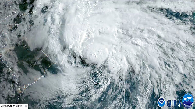 In this satellite image made available by NOAA shows Tropical Storm Arthur off the coast of North Carolina, Monday, May 18, 2020. The storm dropped several inches of rain on parts of eastern North Carolina and flooded roads before moving out to sea away from the state. (NOAA via AP)