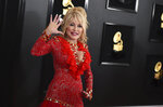 """FILE - Dolly Parton arrives at the 61st annual Grammy Awards on Feb. 10, 2019, in Los Angeles. The Grammy-winning legend's 1980's hit """"9 to 5"""" has been flipped by Squarespace, the company that helps users build and host their own websites, for a Super Bowl commercial debuting Tuesday, Feb. 2, 2021. Oscar winner Damien Chazelle of """"La La Land"""" fame directed the spot. (Photo by Jordan Strauss/Invision/AP, File)"""