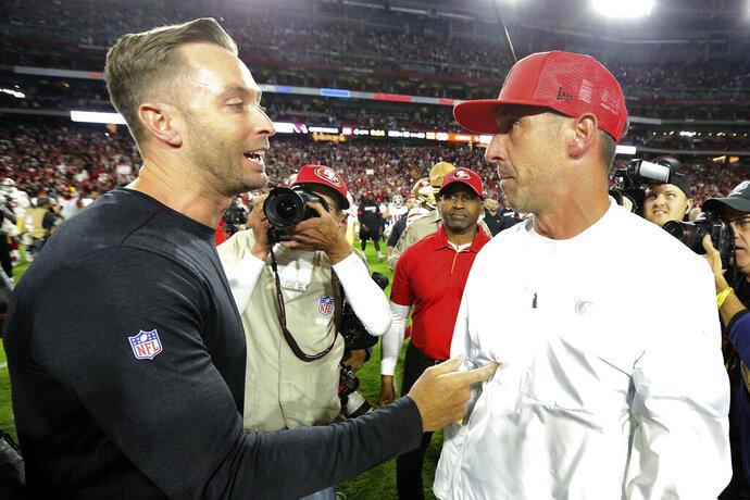 Arizona Cardinals head coach Kliff Kingsbury, left, greets San Francisco 49ers head coach Kyle Shanahan after an NFL football game, Thursday, Oct. 31, 2019, in Glendale, Ariz. The 49ers won 28-25. (AP Photo/Ross D. Franklin)