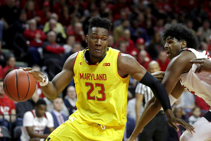 Maryland forward Bruno Fernando (23) drives to the basket as Rutgers center Myles Johnson, right, tries to defend during the first half of an NCAA college basketball game, Saturday, Jan. 5, 2019, in Piscataway, N.J. (AP Photo/Julio Cortez)