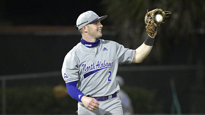 North Alabama infielder Drew Hudson (2) catches a throw during an NCAA college baseball game against Stetson on Friday, Feb. 26, 2021, in Deland, Fla. (AP Photo/Phelan M. Ebenhack)