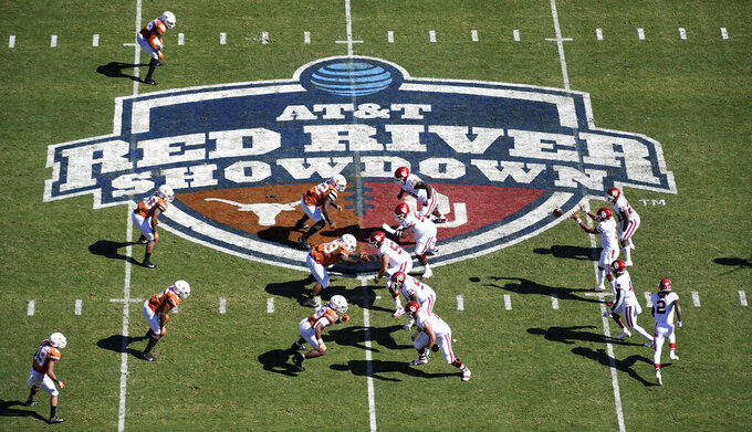 FILE - In this Oct. 12, 2019, file photo, Oklahoma, right, runs a play against Texas in the first half of an NCAA college football game at the Cotton Bowl in Dallas. The Big 12 will have nothing like the Red River rivalry on the second Saturday in October once Texas and Oklahoma make their move to the Southeastern Conference. (AP Photo/Jeffrey McWhorter, File)