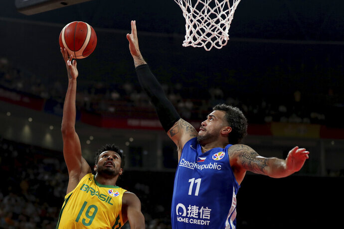 Brazil's Leandrinho Barbosa tries to score past Czech Republic's Blake Schilb during phase two of the FIBA Basketball World Cup at the Shenzhen Bay Sports Center in Shenzhen in southern China's Guangdong province on Saturday, Sept. 7, 2019. (AP Photo/Ng Han Guan)