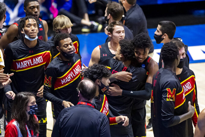 Maryland players gather on the court after defeating Connecticut 63-54 in a first-round game in the NCAA men's college basketball tournament Saturday, March 20, 2021, at Mackey Arena in West Lafayette, Ind. (AP Photo/Robert Franklin)