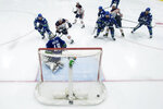 Edmonton Oilers' Tyson Barrie (22) scores against Vancouver Canucks goalie Braden Holtby (49) during the second period of an NHL hockey game, Monday, May 3, 2021, in Vancouver, British Columbia. (Darryl Dyck/The Canadian Press via AP)