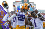 LSU players celebrate after they defeated Auburn on a last second field goal during the second half of an NCAA college football game, Saturday, Sept. 15, 2018, in Auburn, Ala. LSU won 22-21. (AP Photo/Butch Dill)