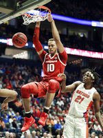 Arkansas forward Daniel Gafford (10) dunks the ball ahead of Florida forward Dontay Bassett (21) in the first half of an NCAA college basketball game at the Southeastern Conference tournament Thursday, March 14, 2019, in Nashville, Tenn. (AP Photo/Mark Humphrey)