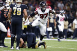 Atlanta Falcons defensive tackle Grady Jarrett (97) celebrates his sack of New Orleans Saints quarterback Drew Brees, on ground, in the second half of an NFL football game in New Orleans, Sunday, Nov. 10, 2019. (AP Photo/Rusty Costanza)