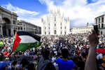 People attend a rally that was held in solidarity with Palestinians, in front of Milan's gothic cathedral, Italy, Thursday, May 13, 2021. (Claudio Furlan/LaPresse via AP)