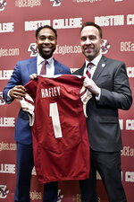 From left, Martin Jarmond, Director of Athletics, and Jeff Hafley hold Hafley's Boston College  Jersey during a news conference where Hafley was introduced as the new NCAA college football head coach at Boston College, Monday, Dec. 16, 2019, in Boston. (AP Photo/Josh Reynolds)