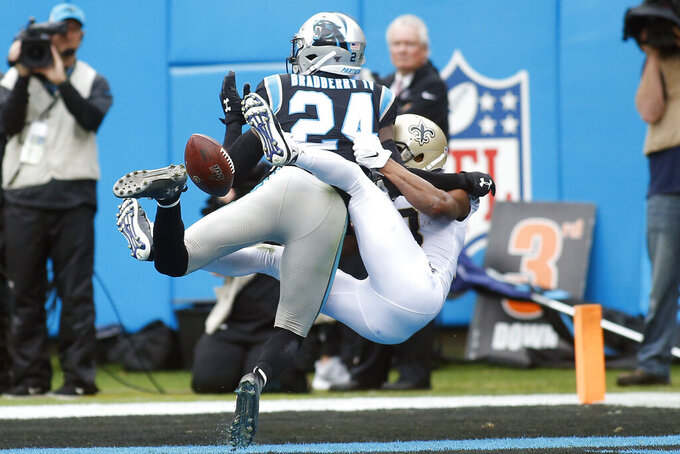 Carolina Panthers cornerback James Bradberry (24) breaks up a pass intended for New Orleans Saints wide receiver Michael Thomas during the first half of an NFL football game in Charlotte, N.C., Sunday, Dec. 29, 2019. (AP Photo/Brian Blanco)