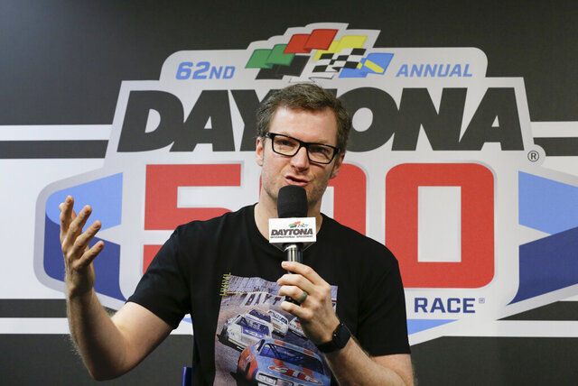 Dale Earnhardt Jr., team owner and TV analyst answers questions during a news conference before the NASCAR Daytona 500 auto race at Daytona International Speedway, Sunday, Feb. 16, 2020, in Daytona Beach, Fla. (AP Photo/Terry Renna)