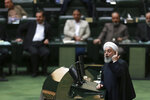 In this Monday, Feb. 4, 2019, photo, Iranian President Hassan Rouhani speaks while defending his proposed health minister in an open session of parliament, in Tehran, Iran. Lashed by criticism over his collapsing nuclear deal, Iran's President Rouhani faces an uncertain future amid a renewed hard-line effort to drive him from office years before his elected term ends. Iranian presidents typically see their popularity erode during their second four-year terms. But analysts say Rouhani is particularly vulnerable because of the economic crisis assailing the country's rial currency, which has hurt ordinary Iranians and emboldened critics to call for his ouster.(AP Photo/Vahid Salemi)