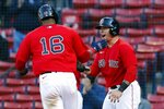 Boston Red Sox's Franchy Cordero (16) and Christian Vazquez celebrate after scoring on a single by Alex Verdugo during the eighth inning of a baseball game against the Detroit Tigers, Thursday, May 6, 2021, in Boston. (AP Photo/Michael Dwyer)