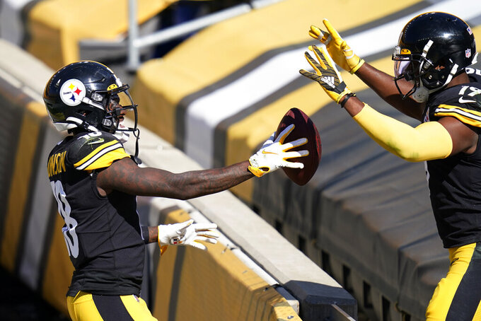 Pittsburgh Steelers wide receiver Diontae Johnson, left, celebrates his touchdown with JuJu Smith-Schuster during the second half of an NFL football game, Sunday, Sept. 20, 2020, in Pittsburgh. (AP Photo/Keith Srakocic)